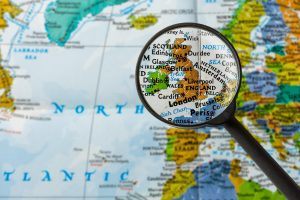 Map of the UK and Ireland under a magnifying glass